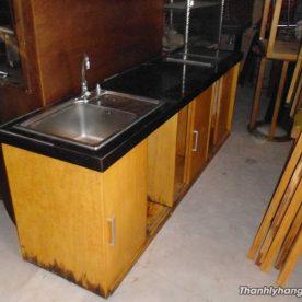 Thanh lý tủ bếp gỗ mặt đá
